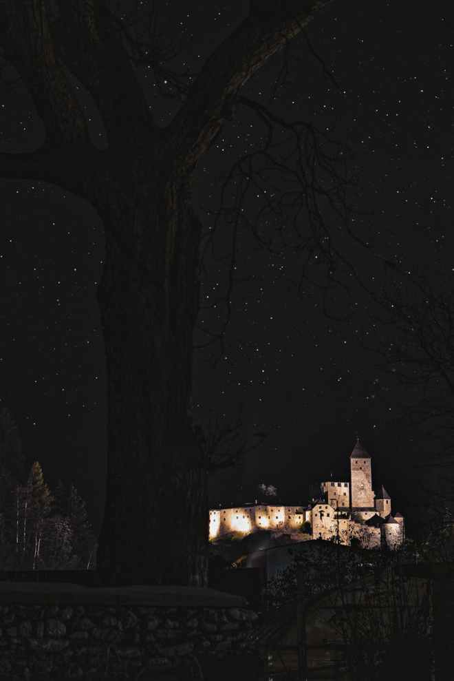 brown castle under a starry sky
